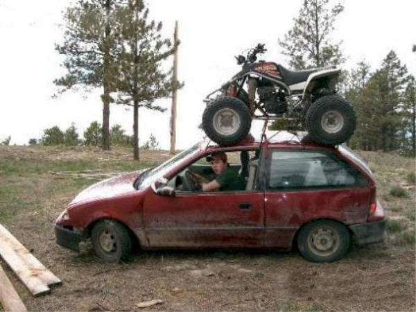 Identify these people.... I found their camera at the Cinders - Arizona-redneck_atv_carrier.jpg
